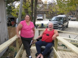 Homeowners with a new wheelchair ramp.