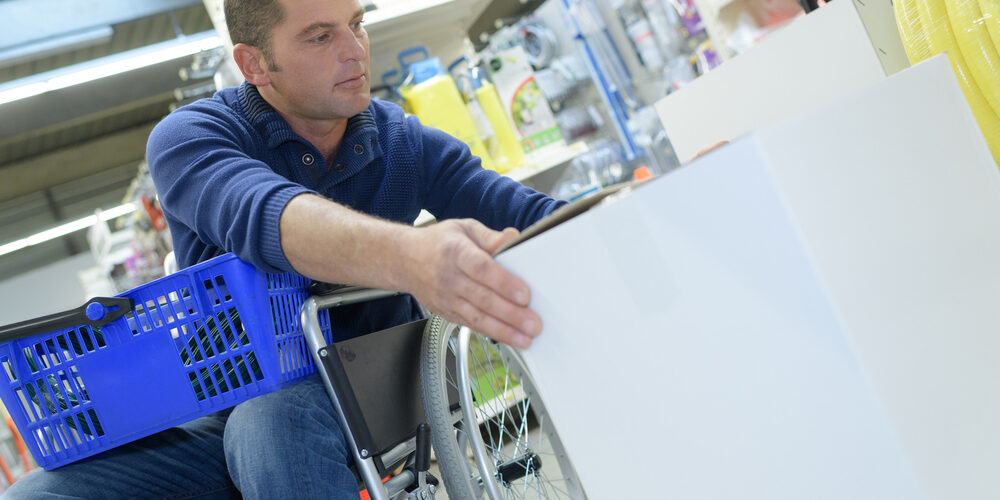 Man in a wheelchair shopping in a store