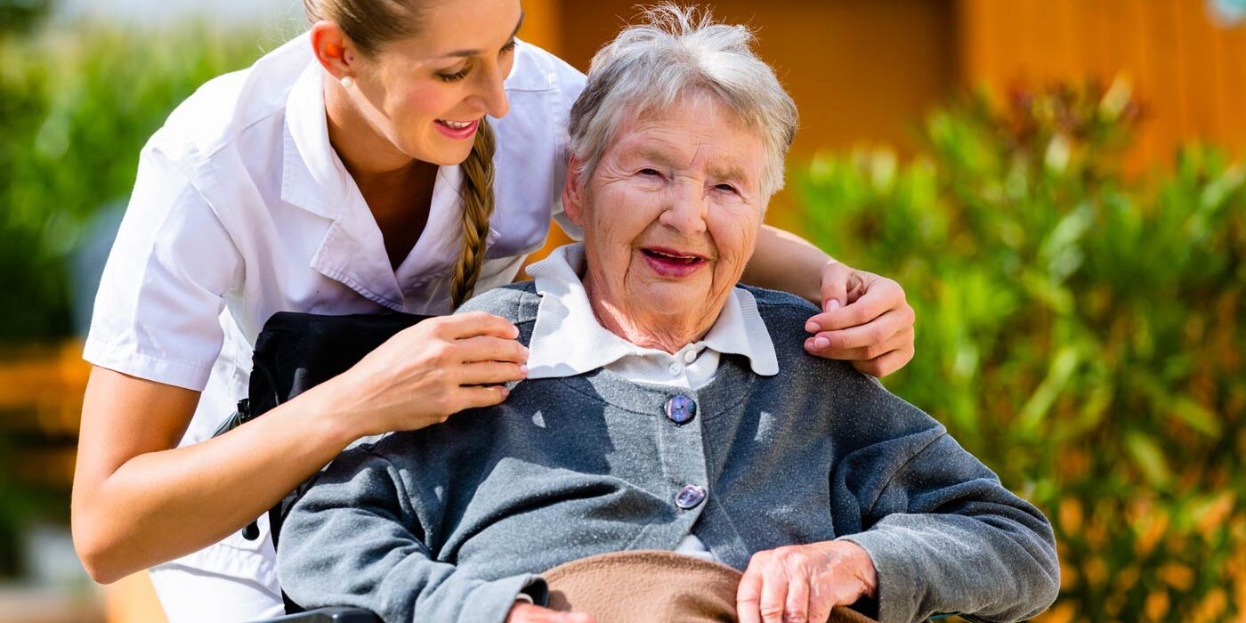 support worker assisting disabled senior citizen